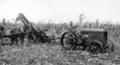 Queensland State Archives 4164 Maize picker at work Atherton North Queensland c 1930.png