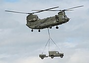 A vehicle being carried underneath a helicopter