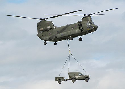 An RAF Chinook with underslung Land Rover, a procedure used to retrieve the Royal Irish patrol's vehicles from Magbeni RAF Chinook.jpg