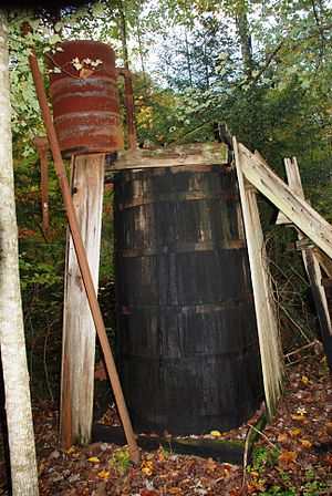 Standard Oil of Kentucky - Pumpjack and wooden oil barrel in the forests around slate is a reminder of the long history of oil industry in Kentucky