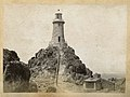 Rock formation and lighthouse (8966369626b).jpg
