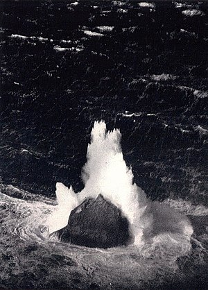 Rockall - Unusually large winter waves breaking over the islet, 11 March 1943