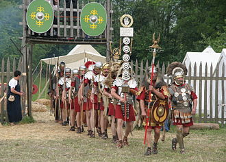 Legio XV Apollinaris - The Savaria Legio XV Apollinaris, reenactors moving off a reconstructed Castra in Pram, Austria.