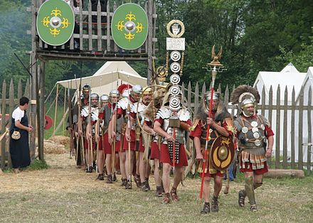 Reenacters portraying Roman legionaries of Legio XV Apollinaris. Roman soldiers with aquilifer signifer centurio 70 aC.jpg