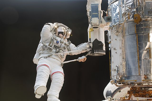 NASA Astronaut in white EVA space suit