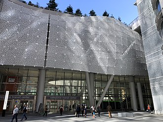 "Transbay Transit Center - The main entrance to the Grand Hall, located at Mission and Fremont Streets.  The outer ""skin"", made of white aluminum, is perforated in the pattern of a Penrose tiling."