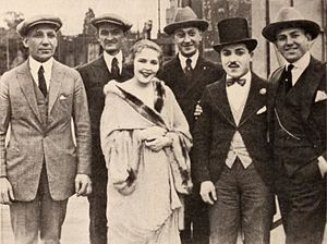 Art Klein - Film producer Sam Warner, exhibitor Joe Marks from Youngstown, Ohio, actress Florence Gilbert, racing pilot Art Klein, comic actor Monty Banks, and film producer Jack L. Warner in 1920.