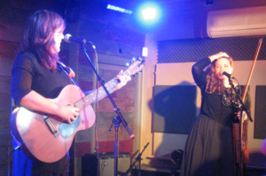 The Be Good Tanyas - Samantha Parton and Jolie Holland performing in Cambridge, England, 2017