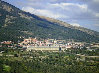 San Lorenzo de El Escorial - View of San Lorenzo de El Escorial, on the slopes of Mount Abantos, from the Silla de Felipe II (Philip II chair). In the foreground, the Monastery of El Escorial.