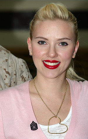 Scarlett Johansson smiles after being pinned w...