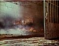 Seaplane hangar on Midway burning 1942.jpg