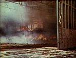Seaplane hangar on Midway burning 1942.jpg