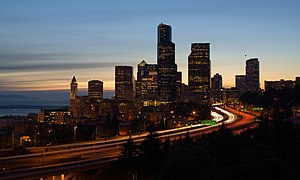 The skyline of Seattle, Washington at dusk. In...