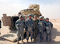 Sgt. Maj. of the U.S. Army Raymond F. Chandler III, center, poses with Soldiers with the 1st Heavy Brigade Combat Team, 1st Cavalry Division at Camp Buehring, Kuwait, April 1, 2012 120401-A-WD324-001.jpg
