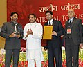 Shashi Tharoor presented the National Tourism Awards, at a function, in New Delhi on February 18, 2014. The Secretary, Ministry of Tourism, Shri Parvez Dewan is also seen (4).jpg