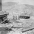 Sherman tanks and infantry in the ruins of Cassino, Italy, 18 May 1944. NA15009.jpg