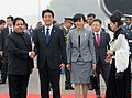 Shinzo Abe and his wife Mrs. Akie Abe being received by the Minister of State for Parliamentary Affairs and Planning, Shri Rajeev Shukla, at Air force station Palam, in New Delhi on January 25, 2014.jpg
