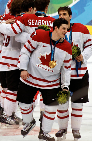 Canada forward Sidney Crosby celebrates with t...