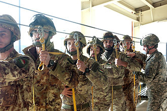 Paracadutisti - Paratroopers of the Folgore Parachute Brigade performing airborne operations training with a U.S. Army jumpmaster