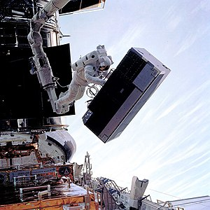 Goddard High Resolution Spectrograph - GHRS being removed during Servicing Mission 2. (1997)