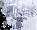 Small child standing next to a St. Bernard dog. (17056976840).jpg