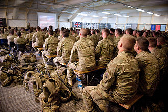 Camp Shorabak - Newly arrived soldiers listen to a briefing in 2012