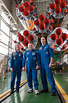 Soyuz TMA-09M crew members in front of the first stage engines.jpg