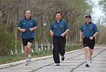 Soyuz TMA-4 crew jog on the grounds of the Cosmonaut Hotel.jpg
