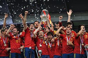 UEFA Euro 2012 - Spain players holding the Henri Delaunay Trophy.