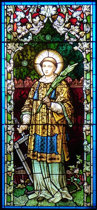 Saint Lawrence - St. Lawrence in stained glass window by Franz Mayer & Co..  He is holding a palm branch, a symbol for martyrdom, and a griddle, the instrument of his death.
