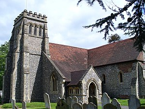 Effingham, Surrey - St Lawrence's church is by and large of 1888 but has a chancel of the 14th century and south transept built in 1250.