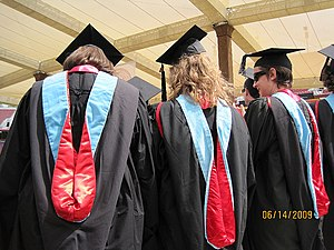 Academic regalia of Stanford University - Three recent graduates of Stanford University wearing their hoods. The light blue velvet is used to designate degrees in the field of education.