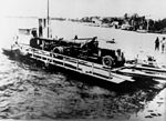 StateLibQld 2 112856 Naval gun being ferried across to Bribie Island, 1939.jpg