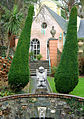 Statue in front of a house in Portmeirion (2004).jpg