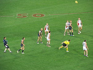 Ball-up - Umpire Matt Stevic bounces the ball in a game between Carlton and St. Kilda, 2011.