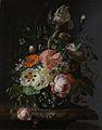Stilleven met bloemen op een marmeren tafelblad Rijksmuseum SK-A-2338.jpeg