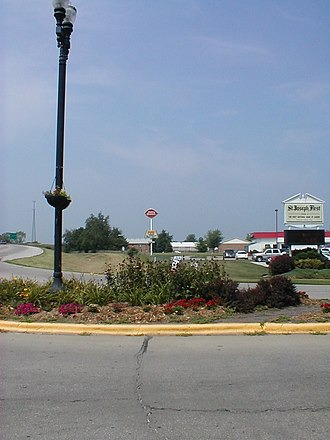 St. Joseph, Illinois - A distant view of the Dairy Queen sign as well as the local bank.