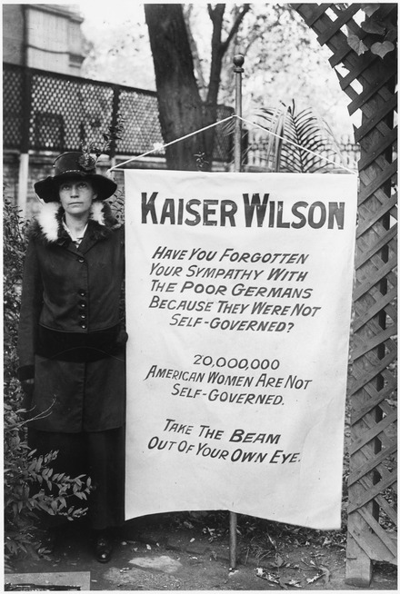 """Kaiser Wilson"" banner held by a woman who picketed the White House Suffragette banner. One of the banners, the women who picketed the White House . . . - NARA - 533769.tif"