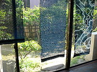 Sunlight filters through tied-and-indigo-dyed (shibori) fabric.jpg