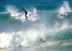 Surfer at Noordhoek Beach, South Africa.jpg