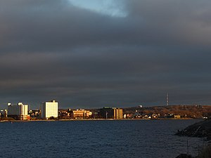 Sydney, Nova Scotia, as seen from Westmount. Prominent landmarks include the Civic Centre, and the CJCB-TV transmitter tower on Hardwood Hill.