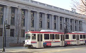 A TRAX train passing the Frank E. Moss Federal...