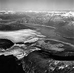 Taku and Norris Glaciers, terminus of tidewater and valley glaciers with braided stream seperating the two glaciers, August 24 (GLACIERS 6182).jpg