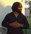 Teacha Dee rastafari picture with hair let down.jpg
