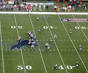Vick (far left) runs the offense against the Lions in a 2005 Thanksgiving Day game