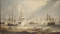Seven ships lie in various states of repair on still waters. On the shore in the foreground large crowds rush towards the sea. Smoke drifts through the scene.