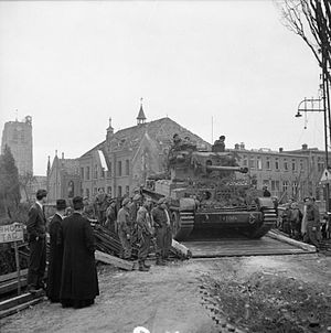 Cruiser Mk VIII Challenger - A Challenger tank crosses a Bailey bridge near Esch, Netherlands. 27 October 1944