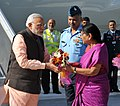 The Prime Minister, Shri Narendra Modi being received by the Chief Minister of Gujarat, Smt. Anandiben Patel, on his arrival at Bhuj, in Gujarat on December 18, 2015.jpg