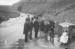Lisdoonvarna - A group taking the waters at the Twin Wells on the banks of the Aille river at Lisdoonvarna, circa 1900