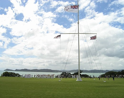 The flag pole at Waitangi, flying (left - right) the Flag of the United Tribes of New Zealand, the Ensign of the Royal New Zealand Navy and the Union Jack, 5 February 2006 The flag post by the treaty house - Waitangi.jpg
